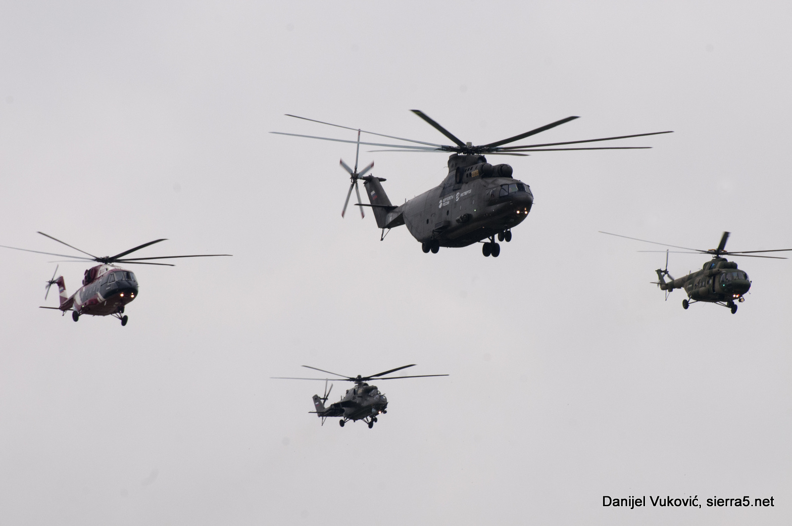 Fly-by of helicopters in flying program opening
