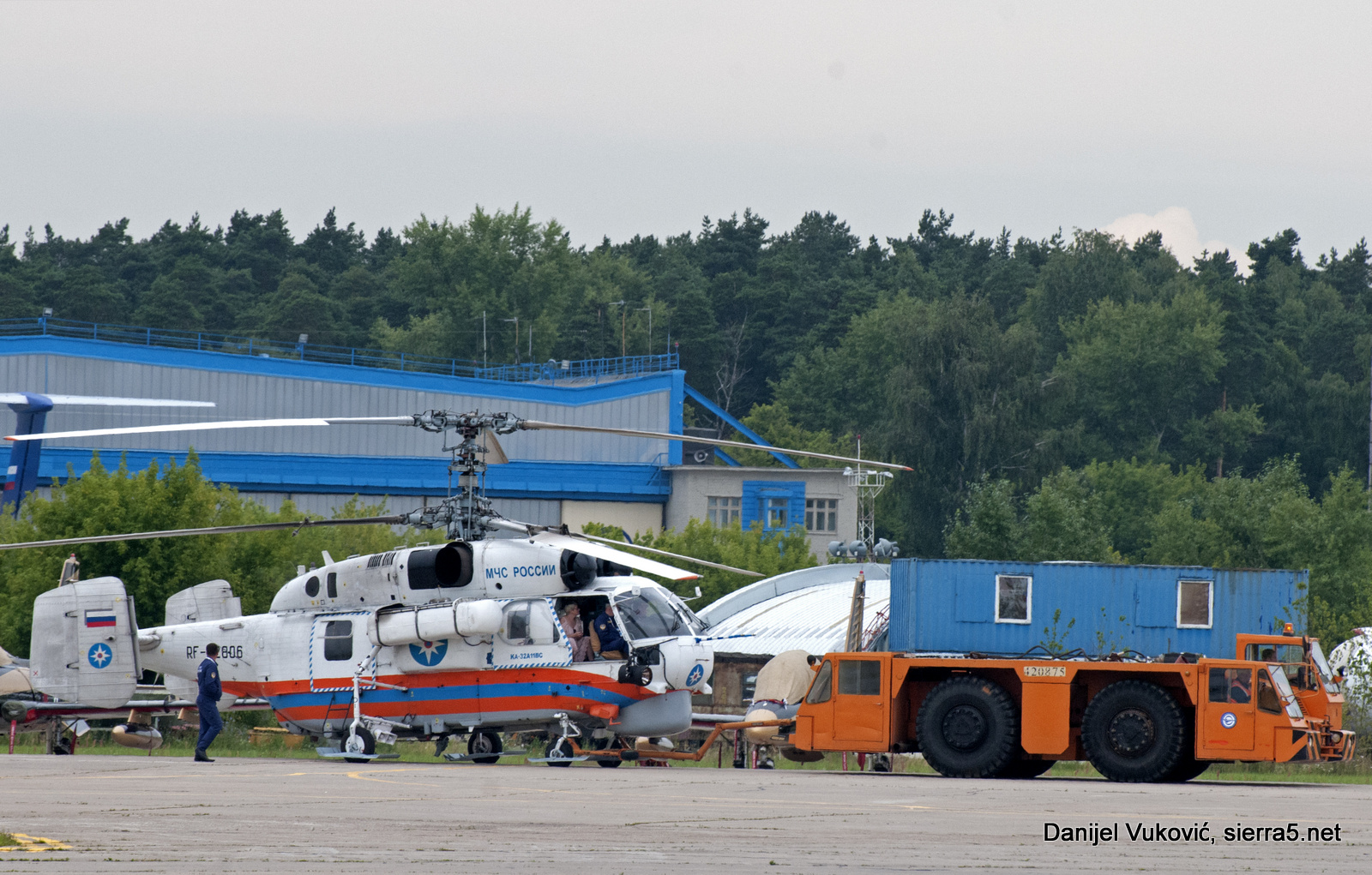Ka-32A11VS has been towed between the crowd